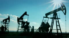 Working oil pumps silhouette Stock Footage