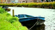 Boat in Gracht / Canal with birds in Harlem near Amsterdam, Netherlands Stock Footage