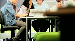 Classmates using modern IT communication in college   Stock Footage