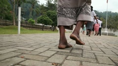 Resident of Sri Lanka walking on the road Stock Footage