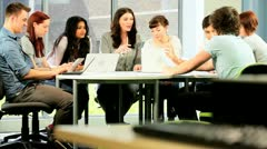 Tutor and students focus on information online in IT room  Stock Footage