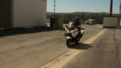 Police motorcycle driving by Stock Footage