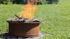 Fire pit in backyard tight shot Stock Footage