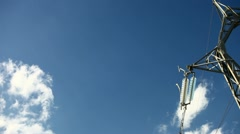 Electrical tower on blue sky (pan) Stock Footage