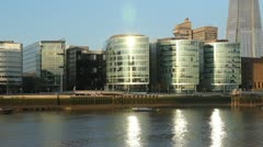 Offices on the Thames. River reflections. Stock Footage