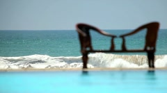 Empty bench on background of the Indian Ocean waves - stock footage