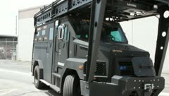 SWAT Truck backing up Stock Footage