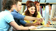 Classmates online learning knowledge in IT hub  Stock Footage