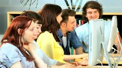Class of friends researching online with lecturer  Stock Footage