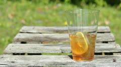 Mixed drink sitting on table outdoor Stock Footage