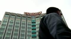 Belfast Europa Hotel, pedestrians Stock Footage