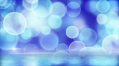 Blue circle bokeh lights and reflection on ice loop Stock Footage