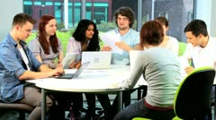 Lecturer and college students working on IT application   - stock footage