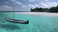 Stock Video Footage of Tropical Paradise at Maldives  - Sail boat with island shore in distance