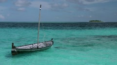 Tropical Paradise at Maldives  - Tilt up to sail boat and island in distance Stock Footage