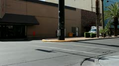 Ambulance driving by on Fremont east district Stock Footage