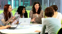 Group of students focus on project instruction tutor   - stock footage
