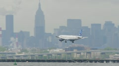 JetBlue Airplane Landing LaGuardia Airport New York City 24p cloudy Stock Footage