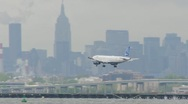 Stock Video Footage of JetBlue Airplane Landing LaGuardia Airport New York City 24p cloudy