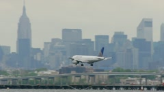 United Airlines Airplane Landing LaGuardia Airport New York City 24p cloudy Stock Footage