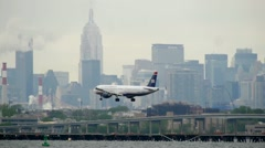 US Airways Airplane Landing LaGuardia Airport New York City cloudy Stock Footage