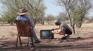 Stock Video Footage of Woman and Man out in the Boonies with Old TV