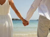 Closeup shot of a couple holding hands on the beach NTSC Stock Footage