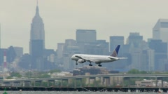 United Airlines Airplane Landing LaGuardia Airport New York City cloudy Stock Footage
