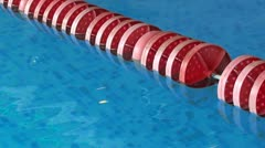 Red float  line in pool Stock Footage