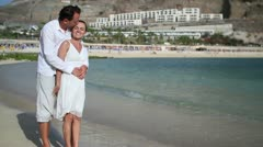 Romantic couple enjoying beach holiday HD Stock Footage