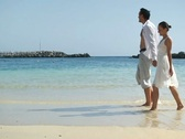 Stock Video Footage of Young couple walking on the beach, slow motion NTSC