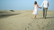 Stock Video Footage of Loving couple walking in the desert HD