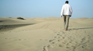 Stock Video Footage of Young man walking in the desert HD