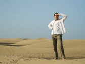 Young man looking around at the desert NTSC Stock Footage