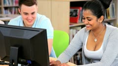Male and female students networking in IT class  Stock Footage