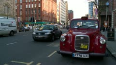 Red Taxi Cab Belfast parked with traffic Stock Footage