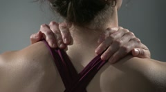 Back pain, woman rubbing her neck Stock Footage