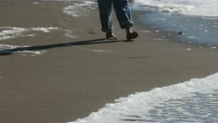 Footsteps on the Beach - stock footage