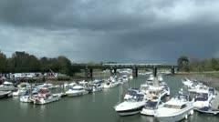 Dark Clouds River Bridge Boats Train Stock Footage