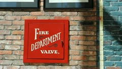 Fire Department Valve Sign on Brick Wall Stock Video     Stock Footage