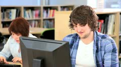 Male and female classmates learning application on Internet  - stock footage