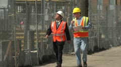 Construction worker and business man visiting construction site - stock footage