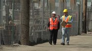 Construction worker and business man visiting construction site Stock Footage