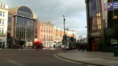 Double Decker Bus, Belfast City Centre Traffic pan Stock Footage