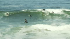 Surfers in the Waves Stock Footage