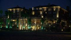 Beach Hotel Lit up at Night - stock footage