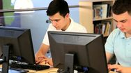 Male students learning online in hub  Stock Footage
