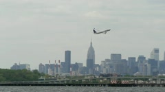 United Airlines Airplane take off leaving LaGuardia Airport New York City - stock footage