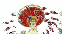 Low angle shot of giant swing at amusement park - white sky background Stock Footage