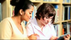 Diverse classmates study on tablet  - stock footage